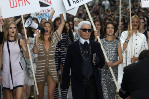 "Karl Lagerfeld at Chanel's ""feminist protest."" Photo by Antonio de Moraes Barros/WireImage"