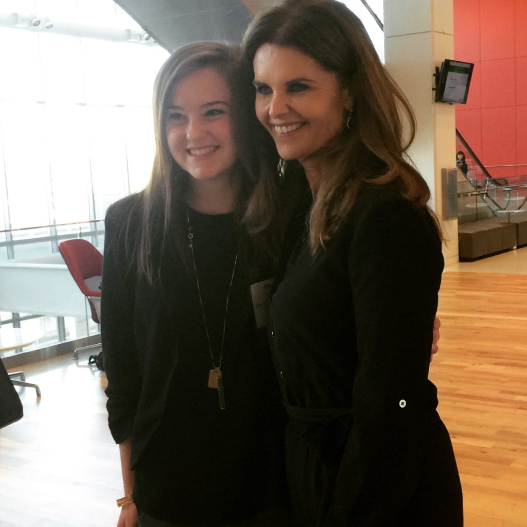 Maria Shriver meets with a young girl attending the summit.