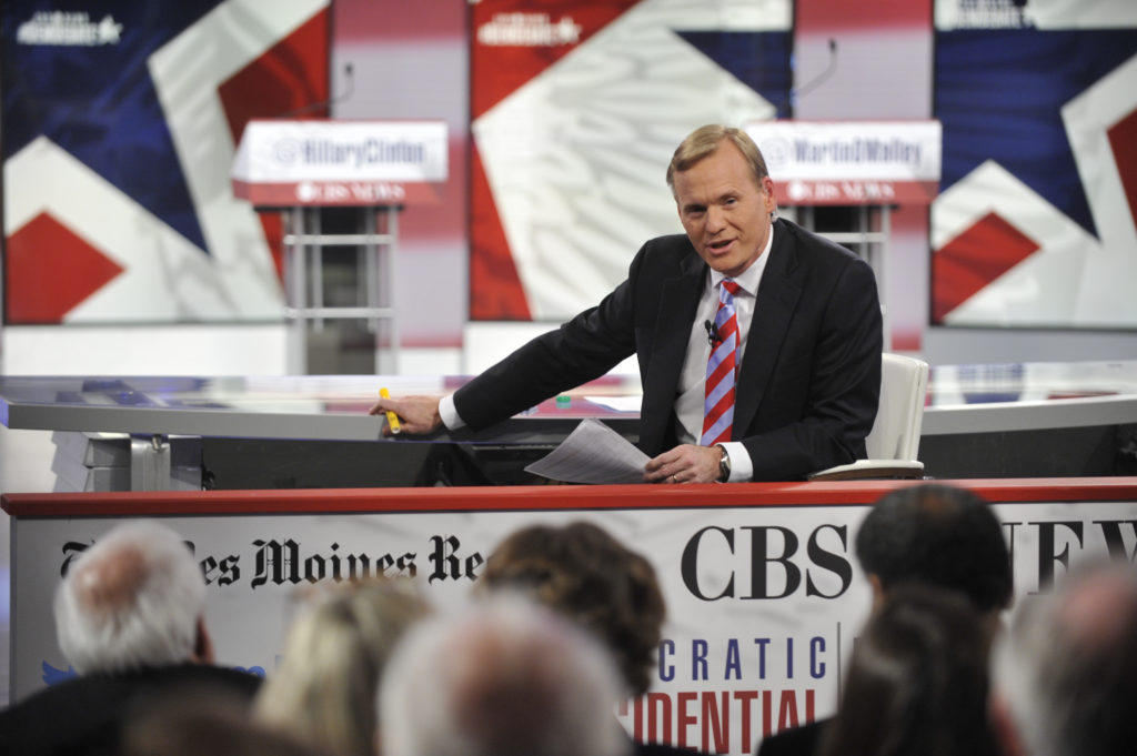 Chris Usher/CBS  © 2015 CBS Television Network. All Rights Reserved. CBS News Political Director and FACE THE NATION anchor John Dickerson moderates the CBS News Democratic Presidential Debate at Drake University Des Moines, Iowa on Saturday, November 14, 2015 on the CBS Television Network. Photo: Chris Usher/CBS  © 2015 CBS Television Network. All Rights Reserved.
