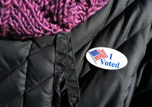 "A woman wears an ""I voted"" sticker after voting in Massachusetts' primary election in the East Boston neighborhood of Boston, Tuesday, March 1, 2016.  Voters from Vermont to Colorado, Alaska to American Samoa and a host of states in between were heading to polling places and caucus sites on the busiest day of the 2016 primaries.(AP Photo/Michael Dwyer)"